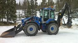 Traktorgrävare – Huddig 1260B